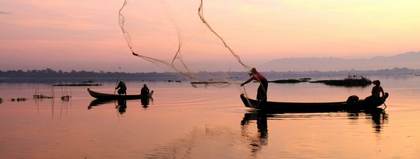 Fishermen throwing a net
